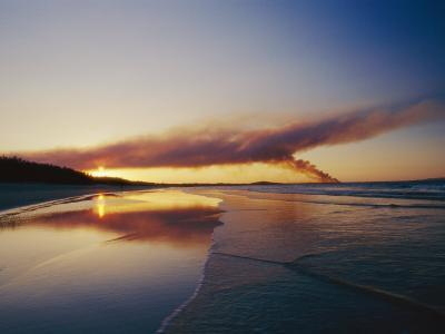 Smoke from a Brushfire Forms a Large Cloud over a Shoreline Bathed in Low Sunlight-Jason Edwards-Photographic Print