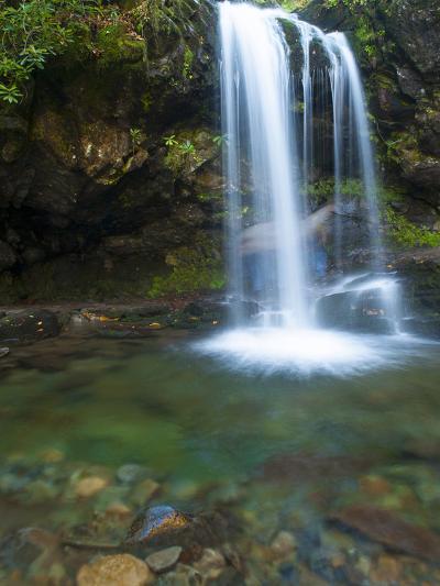 Smoky Mountain Natioanl Park: a Hiker Running Behind Grotto Falls-Brad Beck-Photographic Print