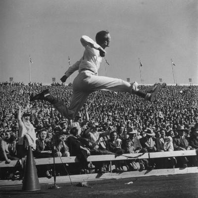 Smu Cheerleader Leaping High into Air at University of Texas Football Game-Loomis Dean-Photographic Print