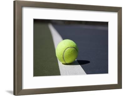 Tennis Ball on a Line in a Court