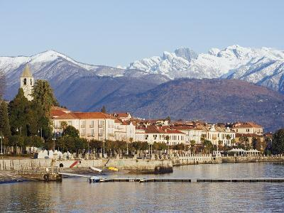 Snow Capped Mountains Above Stresa Waterfront, Lake Maggiore, Italian Lakes, Piedmont-Christian Kober-Photographic Print