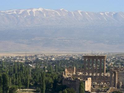 https://imgc.artprintimages.com/img/print/snow-capped-mountains-of-the-anti-lebanon-range-behind-the-roman-archaeological-site-lebanon_u-l-p1nn4l0.jpg?p=0
