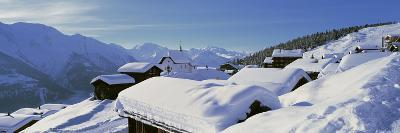 Snow Covered Chapel and Chalets Swiss Alps Switzerland--Photographic Print