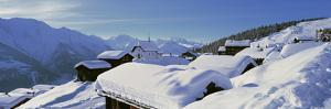 Snow Covered Chapel and Chalets Swiss Alps Switzerland
