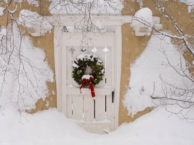Snow Covered Christmas Wreath with a Bow Adorns a Door in Santa Fe-Ralph Lee Hopkins-Photographic Print