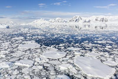 Snow-Covered Mountains Line the Ice Floes in Penola Strait, Antarctica, Polar Regions-Michael Nolan-Photographic Print