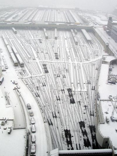 Snow Covers the Railroad Tracks at the Westside Railyard as Snow Falls on New York--Photographic Print
