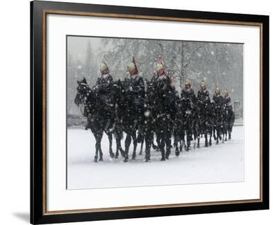 Snow Falling on Members of the Household Cavalry as They Cross Horse Guards Parade--Framed Photographic Print