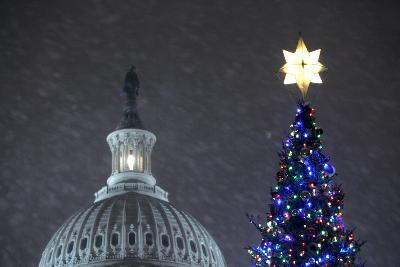 Snow Falls on the U.S. Capitol Christmas Tree During a Lighting Ceremony in Washington, DC, USA-Matthew Cavanaugh-Photographic Print