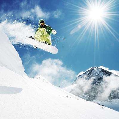 Snowboarder At Jump Inhigh Mountains At Sunny Day-dellm60-Photographic Print