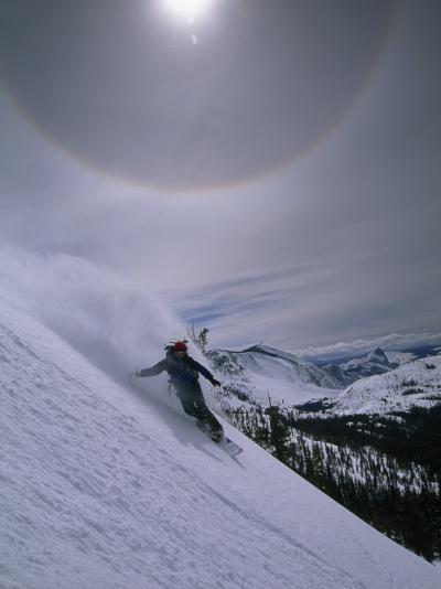 Snowboarding Down a Peak in Yosemite High Country-Bill Hatcher-Photographic Print
