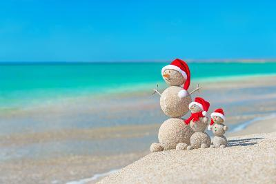 Snowmans Family at Sea Beach in Santa Hat. New Years and Christmas-EMprize-Photographic Print