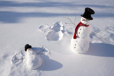 Snowmen in Forest Making Snow Angel Imprint in Snow in Late Afternoon Sunlight Alaska Winter-Design Pics Inc-Photographic Print