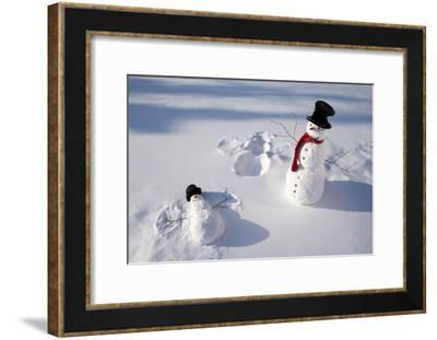 Snowmen in Forest Making Snow Angel Imprint in Snow in Late Afternoon Sunlight Alaska Winter-Design Pics Inc-Framed Photographic Print