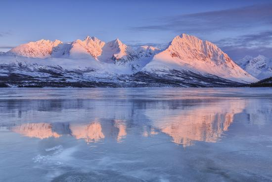 Snowy Peaks are Reflected in the Frozen Lake Jaegervatnet at Sunset, Lapland-Roberto Moiola-Photographic Print