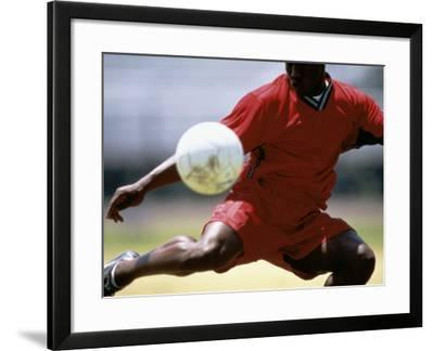 Soccer Player Preparing to Kick Ball--Framed Photographic Print