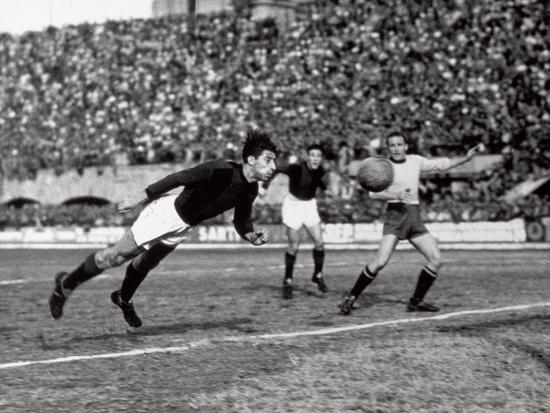Soccer Player Shown While Heading the Ball-A^ Villani-Photographic Print