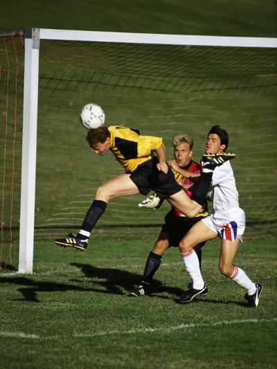 Soccer Players in Action--Photographic Print