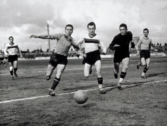 Soccer Players Running after the Ball During a Game-A^ Villani-Photographic Print