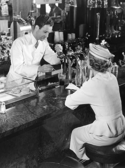 Soda Fountain Attendant Serving Young Woman-George Marks-Photographic Print