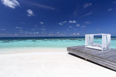 Sofa at the Beach in the Maldives, Indian Ocean-Sakis Papadopoulos-Photographic Print