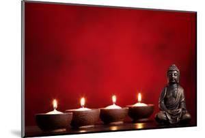 Buddha and Candles on Red Background, Religious Concept. by Sofiaworld