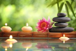 Spa Still Life with Burning Candles,Zen Stone and Bamboo Mat Reflected in a Serenity Pool by Sofiaworld