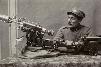 Soldier Near a Machine Gun--Photographic Print