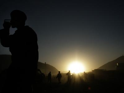 Soldier of the Afghan National Army Drinks Tea at Sunset in Kabul, Afghanistan--Photographic Print