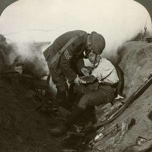 Soldier Receiving First Aid from a Sergeant in a Sap, Battle of Peronne, World War I, 1914-1918