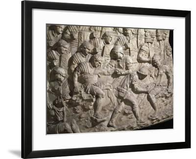 Soldiers Aiding their Wounded Comrades after Battle Against Dacians--Framed Giclee Print