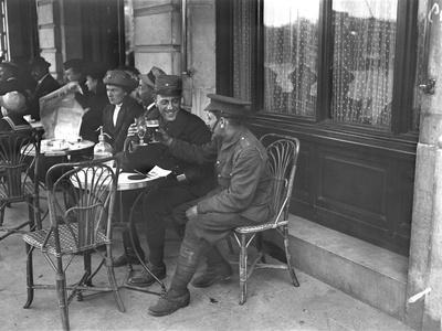 https://imgc.artprintimages.com/img/print/soldiers-drinking-on-a-cafe-terrace_u-l-pjiorm0.jpg?p=0