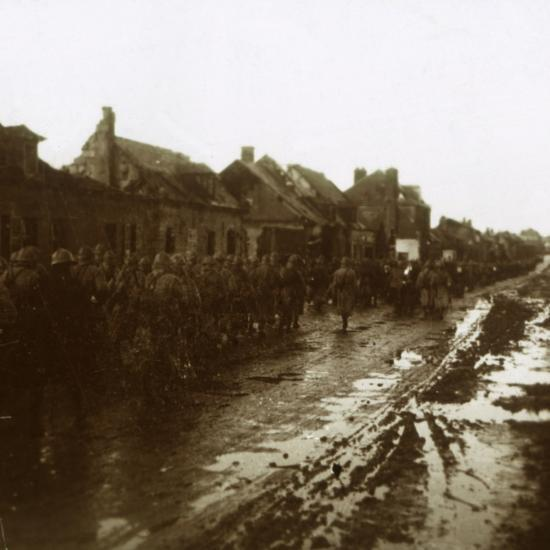 Soldiers marching past bombed-out houses, Champagne, northern France, c1914-c1918-Unknown-Photographic Print