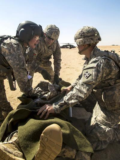 Soldiers Prepare to Load a Wounded Soldier onto a Uh-60 Black Hawk--Photographic Print