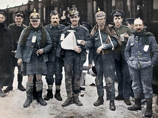 Some cheerful wounded from the Neuve Chapelle fighting, wearing captured German helmets, 1915-Unknown-Photographic Print