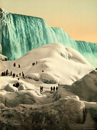 Some People Walk on the Snow, at Their Back, the Niagara's Falls--Photographic Print