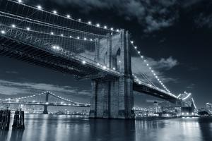 Brooklyn Bridge over East River at Night in Black and White in New York City Manhattan with Lights by Songquan Deng