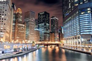 Chicago River Walk with Urban Skyscrapers Illuminated with Lights and Water Reflection at Night. by Songquan Deng