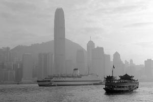 Hong Kong Skyline with Boats in Victoria Harbor in Black and White. by Songquan Deng