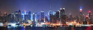 New York City Manhattan Midtown Skyline at Night with Skyscrapers Lit over Hudson River with Reflec by Songquan Deng