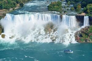 Niagara Falls Closeup Panorama in the Day over River with Rocks and Boat by Songquan Deng
