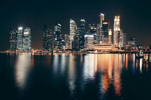 Singapore Skyline at Night with Urban Buildings by Songquan Deng
