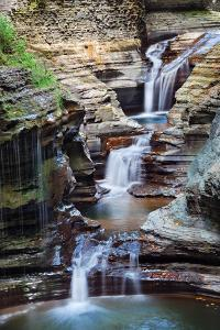 Waterfall Closeup in Woods with Rocks and Stream in Watkins Glen State Park in New York State by Songquan Deng
