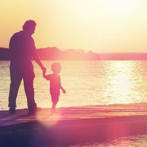 Father and Son Walking Out on a Dock at Sunset by soupstock