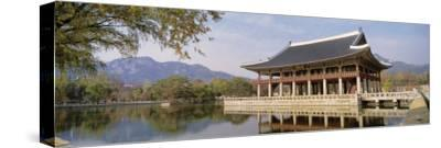 South Korea, Seoul, Kyongheru, View of Traditional Architecture on a Lake