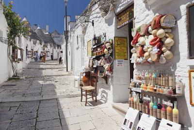 Souvenir Shop on Street of Trulli, Traditional Houses, Rione Monti Area-Markus Lange-Photographic Print