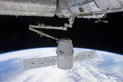 Spacex Dragon During its Docking with the International Space Station--Photographic Print