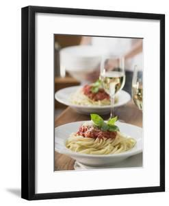Spaghetti with Tomato Sauce and Glasses of White Wine on Table
