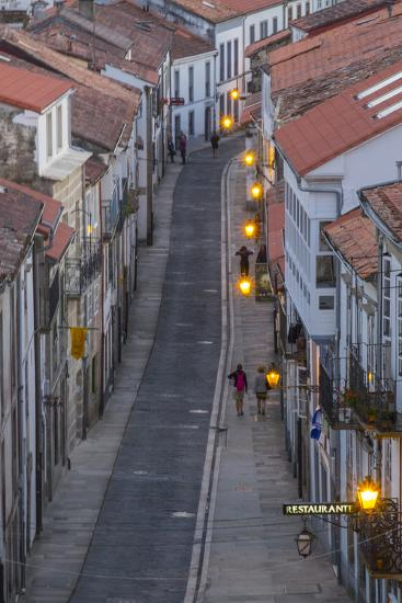 Spain, Santiago. Cobblestone Narrow Street Scene at Twilight-Emily Wilson-Photographic Print