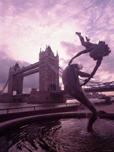 Splashing Fountain of Cherub Catching a Dolphin by the Tower Bridge in London, England